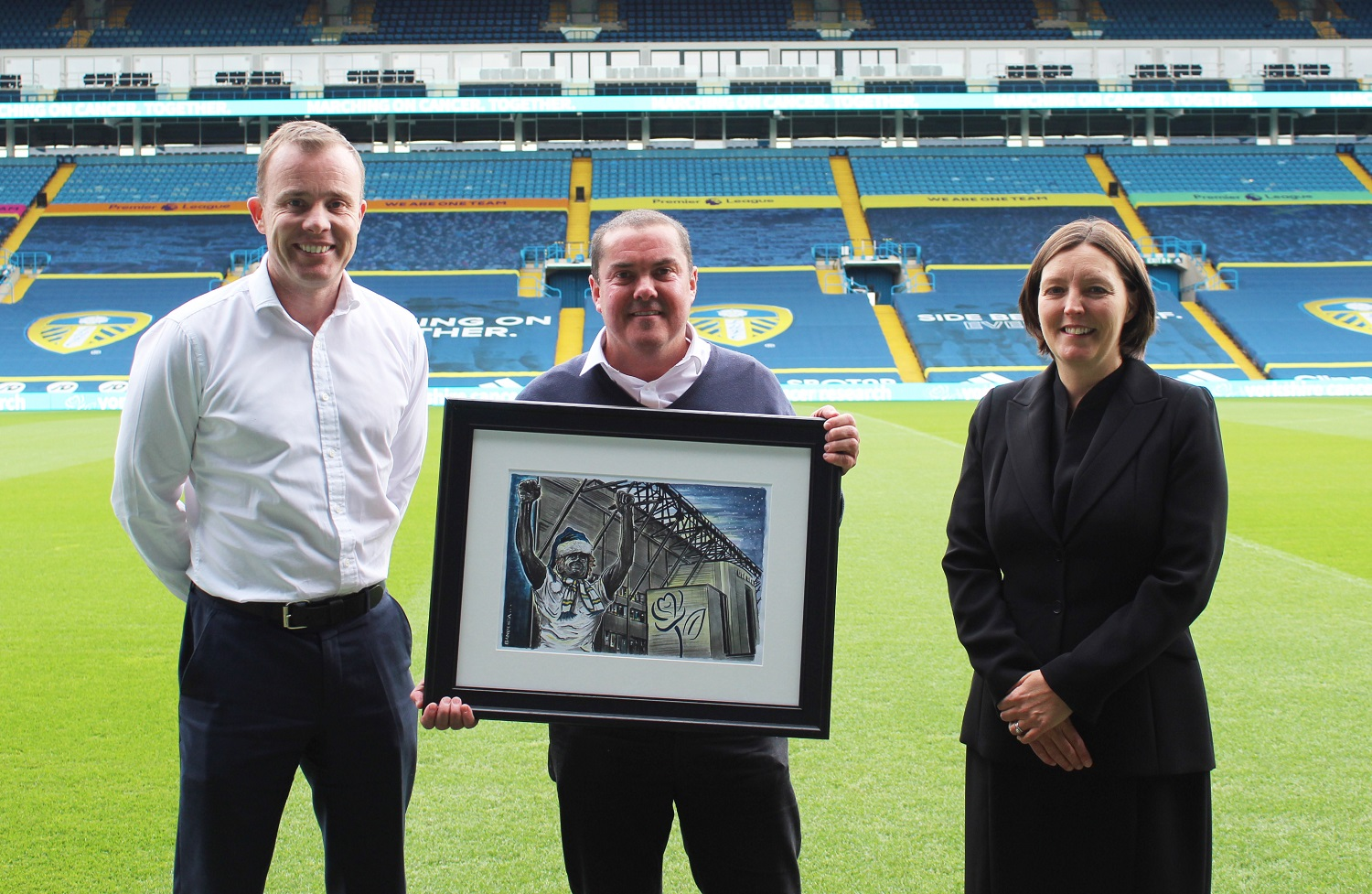 Illustrator Graeme Bandeira with Yorkshire Cancer Research Chief Executive, Kathryn Scott, and Leeds United Chief Executive, Angus Kinnear