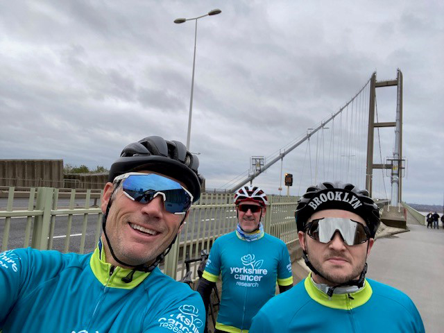 Simon, Colin and Siddy cycling on the Humber Bridge