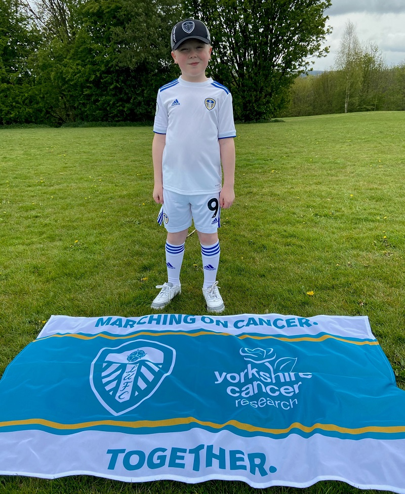 Alfie, 10, with Marching on Cancer flag