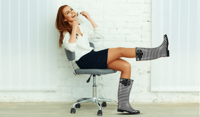 A lady wearing striped wellies